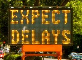 Karen McCann Expect Delays Sign