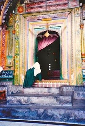 Woman peeking in temple in Kashmir, India